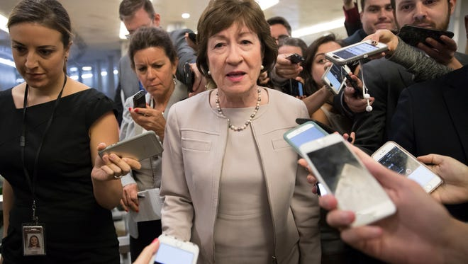 Sen. Susan Collins, R-Maine is surrounded by reporters as she arrives on Capitol Hill in Washington, Tuesday, July 25, 2017.
