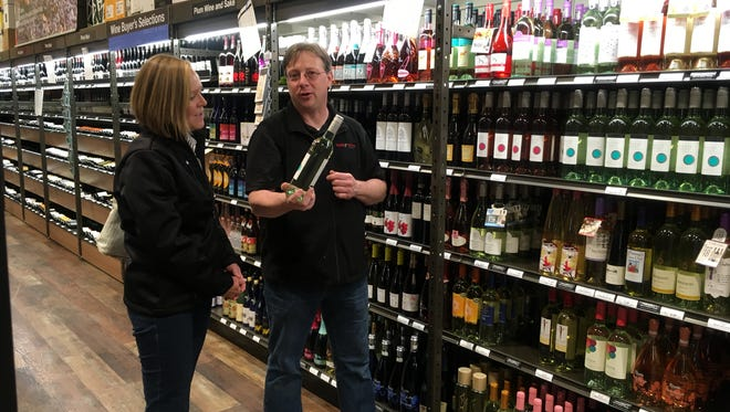 Todd Giammo, manager of Wisconsin's first Total Wine & More store in Brookfield, chats Friday with Carol White, president of the Greater Brookfield Chamber of Commerce, during a press event Friday. The store is scheduled to open Nov. 10.