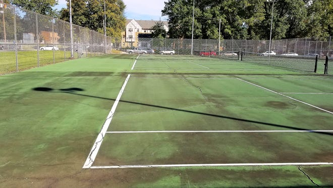 The tennis courts at the University of Evansville have  aged poorly. They are cracked and not suitable for play at an NCAA Division I university.