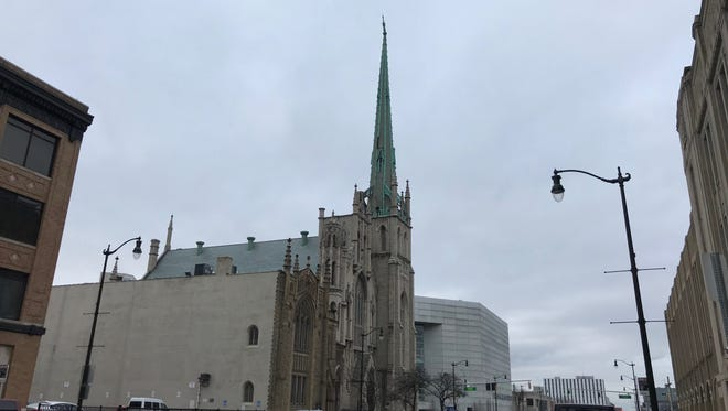 The steeple of the Fort Street Presbyterian Church of Detroit stands crooked after damage from wind and snow.