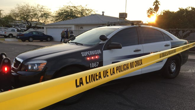 Mesa police at the scene of a shooting involving an officer on Feb. 15, 2018.
