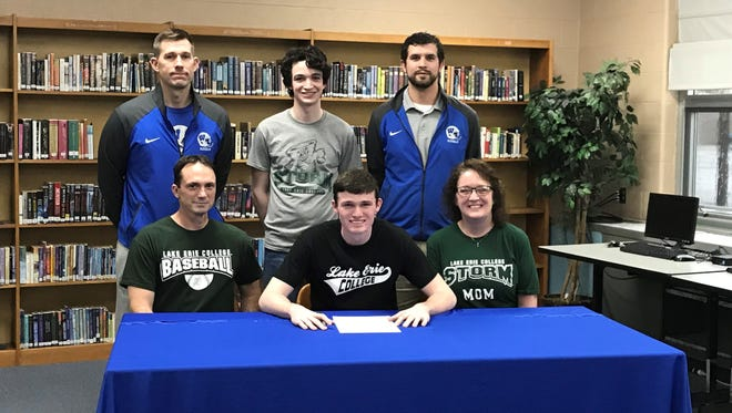 Wynford's Wyatt Smith, surrounded by family and coaches, commits to Lake Erie College.