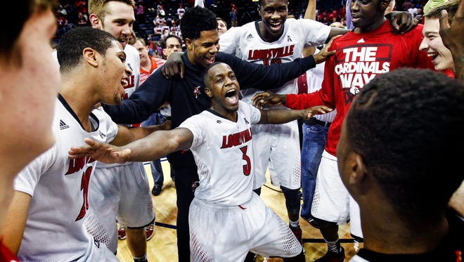 March 15, 2014 - Memphis native and Louisville guard Chris Jones (middle) celebrates with his teammates after defeating UConn in the American Athletic Conference tournament championship game at FedExForum. (Mark Weber/The Commercial Appeal)
