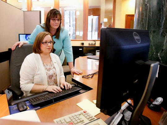 Lauren Little, seated, the operations service associate of bank operations for Chemung Canal Trust, and Sheila Washburn, the bank's vice president of ATM and checkcard operations manager, are involved with the fraud department.
