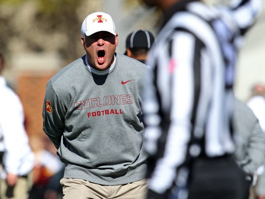 Iowa State Cyclones head coach Paul Rhoads argues a call during the second quarter against the Oklahoma State Cowboys. Hey Paul, you mad bro?