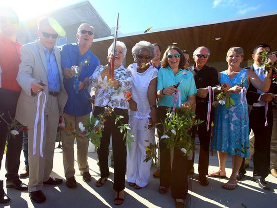 City officials and Oso Bay employees gather during the ribbon cutting of the Oso Bay Wetlands Preserve & Learning Center on Friday, June 10, 2016, in Corpus Christi.