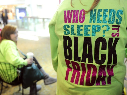 Sherrie Sturkie of Martin, Tenn., and other family members wear matching T-shirts during the 2013 Black Friday shopping at CoolSprings Galleria.