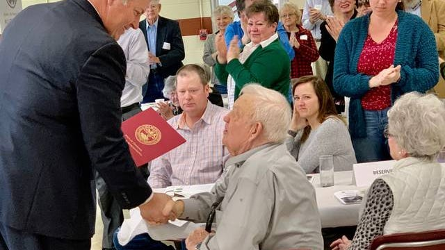 State Rep. Scott Cepicky, left, presents a proclamation from the Tennessee State Capitol to the Whiteside family of Hampshire, who were honored as this year's Century Farm at the 2020 Farm City Breakfast on Friday, March 6, 2020.