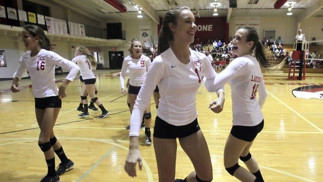 """Evangelical Christian School?s Savannah Tessier, center, and Emily Laquidara dance to ?Cotton-Eyed Joe? during a timeout Tuesday in a regional volleyball game. ECS defeated First Baptist to advance.  SARAH COWARD/THE NEWS-PRESS Evangelical Christian School's Savannah Tessier, center, and Emily Laquidara, joined by teammates, do an impromptu square dance as the song """"Cotton-Eyed Joe"""" plays during a time out Tuesday, October 29."""