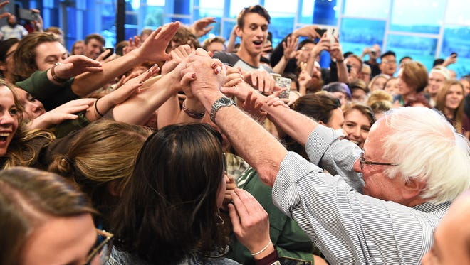 Bernie Sanders reaches into the crowd after speaking at a get-out-the-vote rally at CSU on Monday, October 17, 2016.