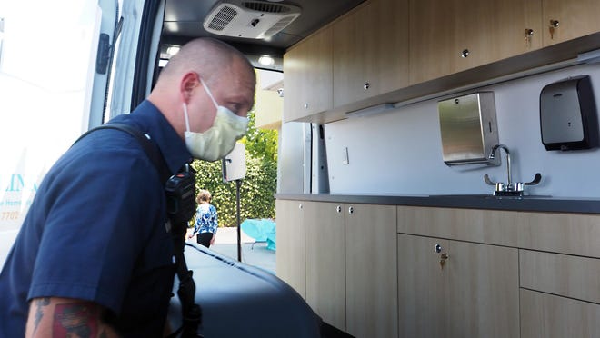 Stockton firefighter Thomas Ellot takes a look inside the new Community Medical Centers' Mobile Health Van.