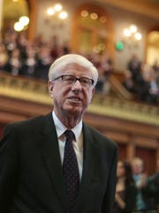 Iowa Attorney General Tom Miller enters the House Chambers