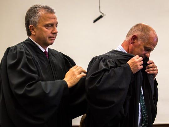 District Judge Dirk Sandefur helps newly appointed
