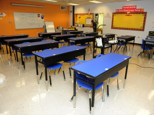 News school desks are shown in a classroom in the new renovated East Camden Middle School.