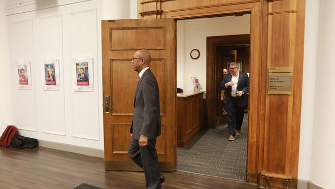 Ohio State University President Michael V. Drake departs his office last spring for a news conference about the coronavirus. Drake has left his OSU office permanently and will become president of the University of California system.