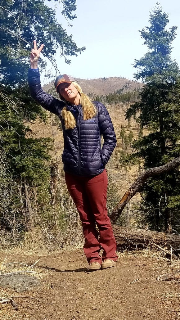 Ana Dozier takes a break on the T13 while hiking with