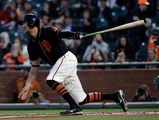 San Francisco Giants' Hunter Pence singles against the Oakland Athletics during the first inning of an exhibition baseball game Friday, March 31, 2017, in San Francisco. (AP Photo/Marcio Jose Sanchez)