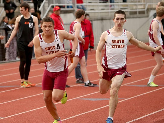 South Kitsap's Deyondre Davis (left) takes the handoff from Devon Keyt in the 4x400 relay during the team's meet against Central Kitsap. Davis is healthy after recovering from injuries he suffered during football and wrestling.