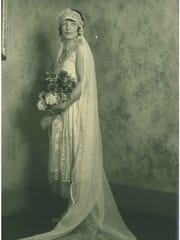 Marian Beery, daughter of Dr. George O. Beery, is shown in her wedding gown on Nov. 16, 1926. She married John F. Furniss in her parents' home at 201 E. Main St.