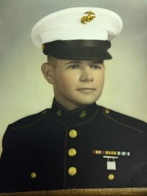 A portrait of Tom Rhen in his U.S. Marine uniform was taken when he was 17 and stationed in Hawaii before being deployed to Vietnam in 1967.