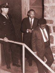 The Rev. Martin Luther King Jr. leaves the building after his 1967 speech in Wausau.