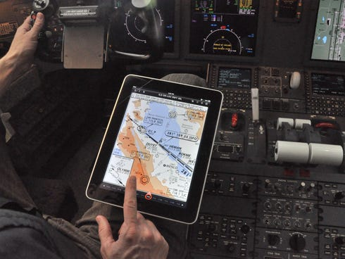 Pilots at some airlines already use iPads in the cockpit, to reduce the amount of paperwork they carry.