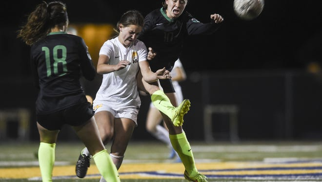 Fossil Ridge's Kenady Adams, right, competes for a ball against Rocky Mountain's Jade Gosar in a game last season.