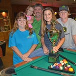 Pool champion Deanna Wilder, 14, of Carthage, poses for a photo with her family. From left are Sandy Wilder, Pattie Marie Wilder, Michael Wilder and Sam WIlder.