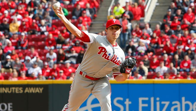 Philadelphia Phillies starting pitcher Jeremy Hellickson throws against the Cincinnati Reds during the first inning at Great American Ball Park.