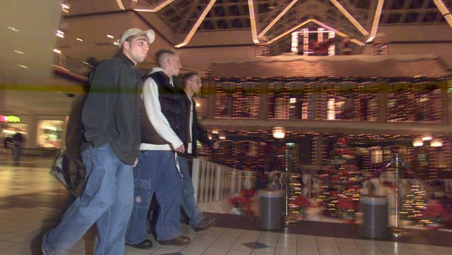 Shoppers stroll through Irondequoit Mall.