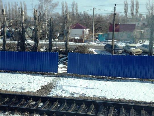Blue Fence Russia railroad track