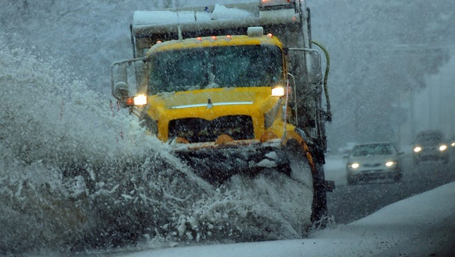 A PennDOT snow plow clears a section on U.S. 11, Chambersburg, near North Pointe Business Center Wednesday, November 26, 2014.