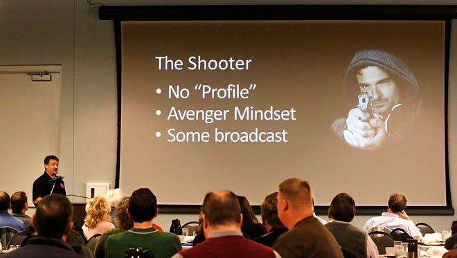 """Scott Krause, a detective with the Fond du Lac Police, talks to around 75 people at the Holiday Inn Convention Center Tuesday afternoon during the program  """"Active Shooter: Learn how to defend and protect yourself in a crisis."""""""