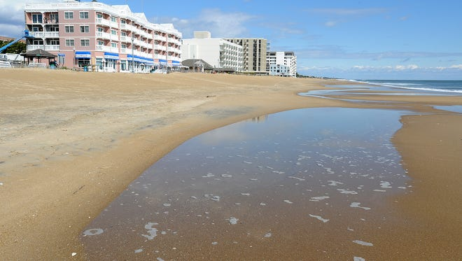 Tide pools form on Rehoboth Beach just after high tide last week.