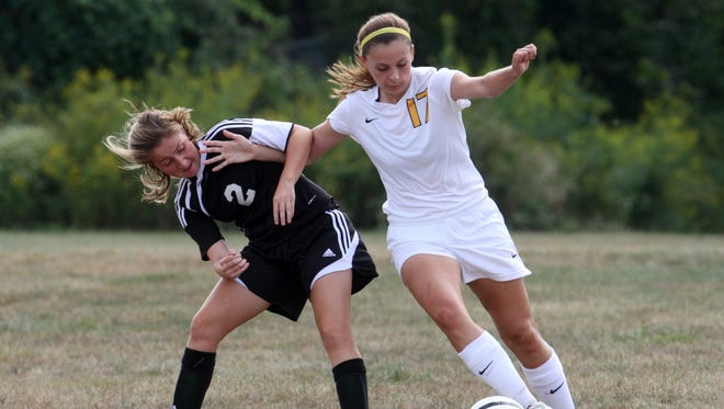 Old Bridge's Breanna Jacinto (left) and Piscatway's Erin Buchinski battle for posession during the first half in 2014.