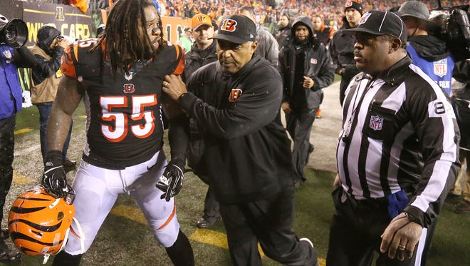 Cincinnati Bengals outside linebacker Vontaze Burfict (55) is restrained by Cincinnati Bengals head coach Marvin Lewis, center, as he gestures toward an official at the conclusion of the NFL AFC wild-card game between the Pittsburgh Steelers and the Cincinnati Bengals, Saturday, Jan. 9, 2016, at Paul Brown Stadium in Cincinnati. The Steelers defeated the Bengals 18-16. With 22 seconds left, Burfict was penalized after hitting Steelers wide receiver Antonio Brown in the head with his shoulder as Brown fell backward to the turf.