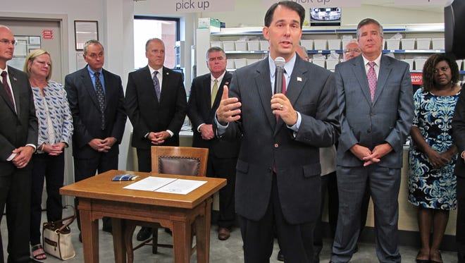 Gov. Scott Walker announced the creation of a state task force to address the Wisconsin's troubling increase in opioid abuse at a Walgreens pharmacy at 3522 W. Wisconsin Ave.