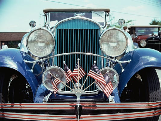 American flags in grill of antique car