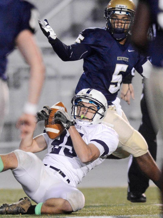 West York's Devon Fissel comes down with an interception Friday night in the District 3 Class AAA championship game. The Bulldogs lost to Bishop McDevitt, 21-10. (Daily Record/Sunday News -- Kate Penn)