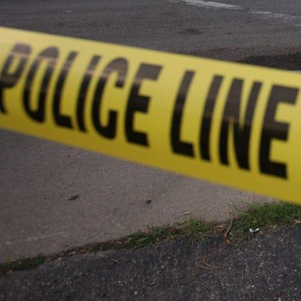 Police close off a scene of a crime.