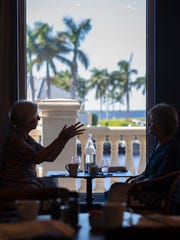 """Kathy Myerd and Linda Jacobs enjoy a lunch at the new """"Gather"""" restaurant in Tarpon Point Thursday, October 26 2017."""