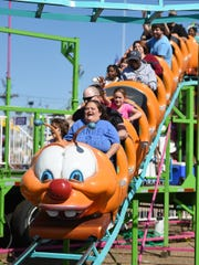 Kids Day at the Mississippi State Fair saves parents a coupon per ride.