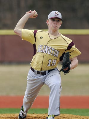 Arlington High School's Evin Kleinganz pitches against John F. Kennedy on April 5, 2014, in Freedom Plains.