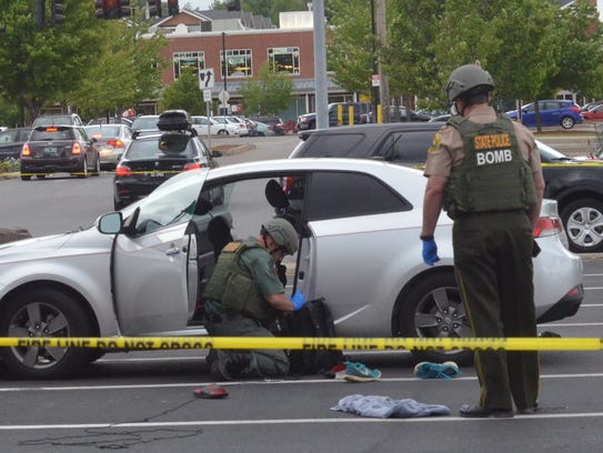 Members of the Vermont State Police bomb squad investigate