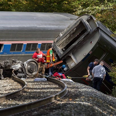 Crews work at the scene of an Amtrak passenger train derailment near Bull Run Road in Northfield on Monday, October 5, 2015, after the train struck fallen rocks. Most passengers were escaped injury but one was flown to Dartmouth Hitchcock Medical Center.
