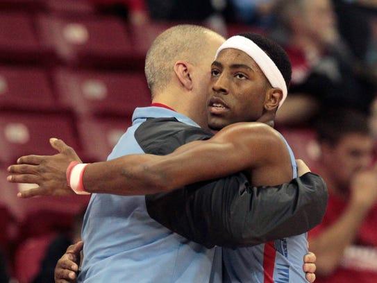 Arrowhead's Trevell Cunningham hugs coach Craig Haase