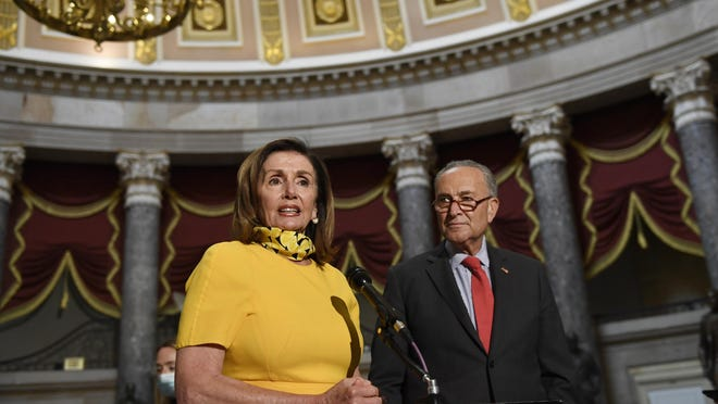 House Speaker Nancy Pelosi of Calif., left, speaks as she stands next to Senate Minority Leader Sen. Chuck Schumer of N.Y., right, on Capitol Hill in Washington, Monday, Aug. 3, 2020. Schumer and Pelosi met earlier with Treasury Secretary Steven Mnuchin and White House Chief of Staff Mark Meadows as they continue to negotiate a coronavirus relief package.