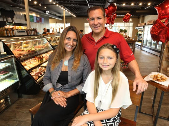 Jimmy Pecci with his wife Stacie Pecci and daughter Helena Pecci at Jimmy Pecci's Taste of Italy on Sycamore Avenue in Tinton Falls.