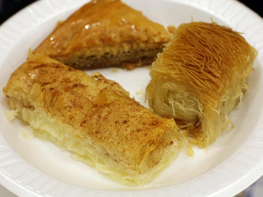 Examples of greek pastries for sale are galactobouriko, front, baklava, rear, and kataifi, right, at the Greek Festival at Saint Barbara Greek Orthodox Church Sunday, September 27, 2015 in Toms River, NJ.
