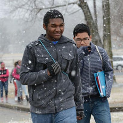 This Feb. 9, 2015, photo shows Jovon Young, left, and